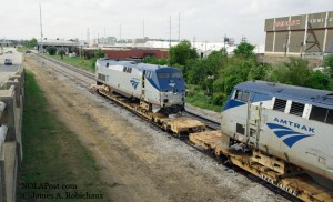 011885 RGB wnp © -- damaged Amtrak locomotives from April Slidell wreck parked along Earheart under Broad Street -- New Orleans, Louisiana, USA -- 19 09 2011